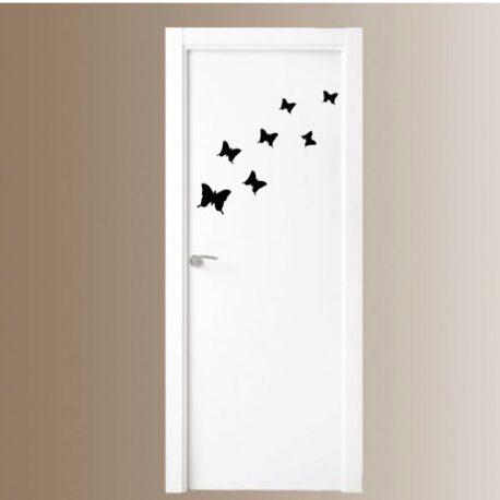 vlinders op deur